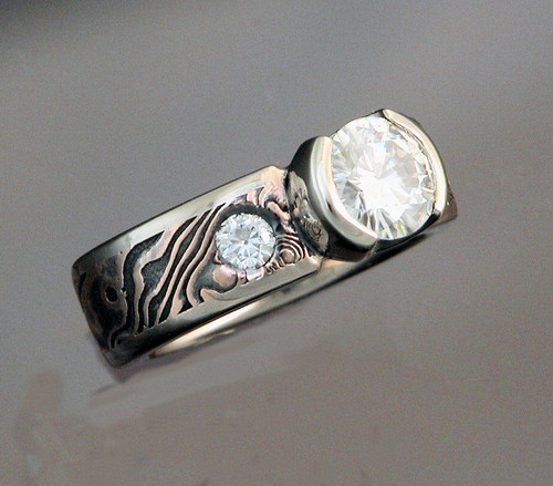 MK601 - 18k Rose Gold with Shakudo Mokume Gane Ring with Half Bezel Head and Moissanite.  Side Stones are inset for extra comfort.