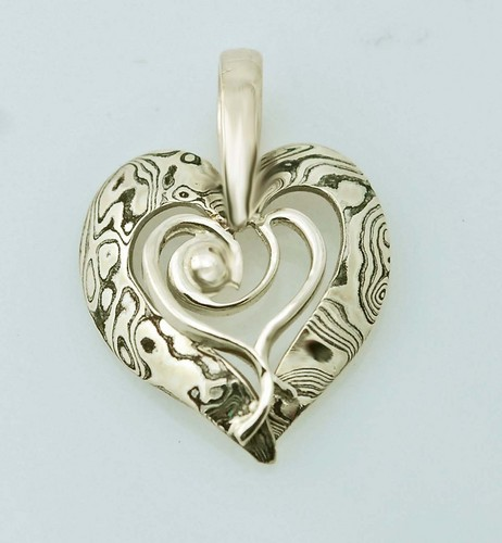 Beautiful Mokume Gane pendant with custom center.  Work with Deb Miller to customize your heart!