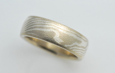 MK203 - 14K Palladium White Gold with Sterling Silver Mokume Gane. This band is a wood grain pattern with eggshell finish. Each ring is made to your specifications