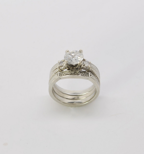 14kt white gold wedding set with 1ct center diamond.