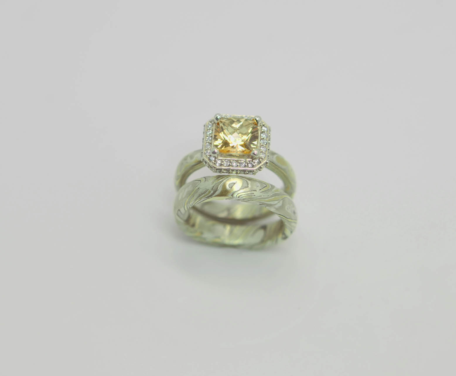 18kt yellow gold,14kt white gold,sterling silver mokume gane .25cttw diamonds and honey topaz.