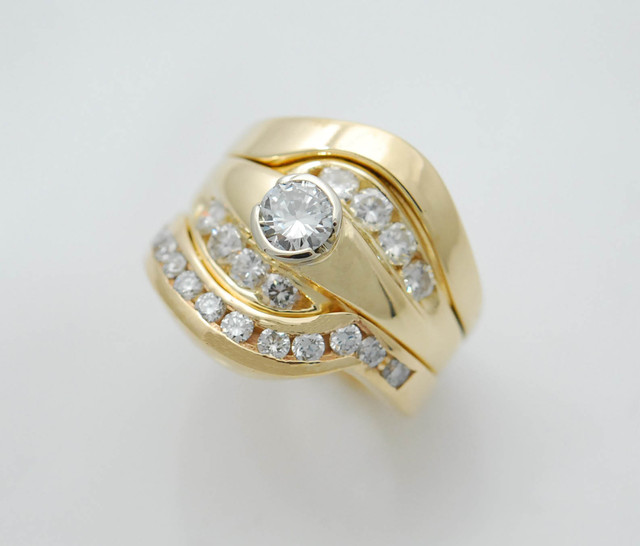 CAD602 Custom designed and created 14k yellow gold wedding set using customers diamonds.