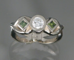 WR16 14k white gold custom ring with .48ct round and .20ct tw green princess cut diamonds.
