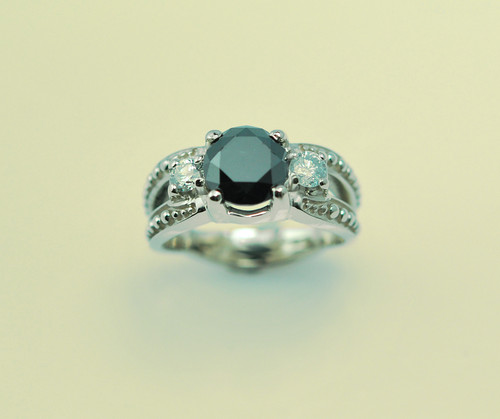 14kt white gold with 2.84ct black diamond and .30cttw white diamond.